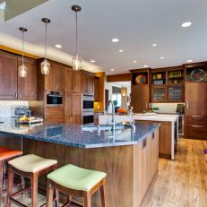 Brown Open Plan Kitchen With Multicolored Stools