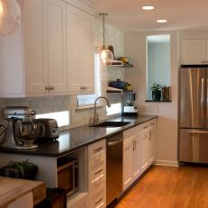 White Kitchen With Stainless Steel Refrigerator
