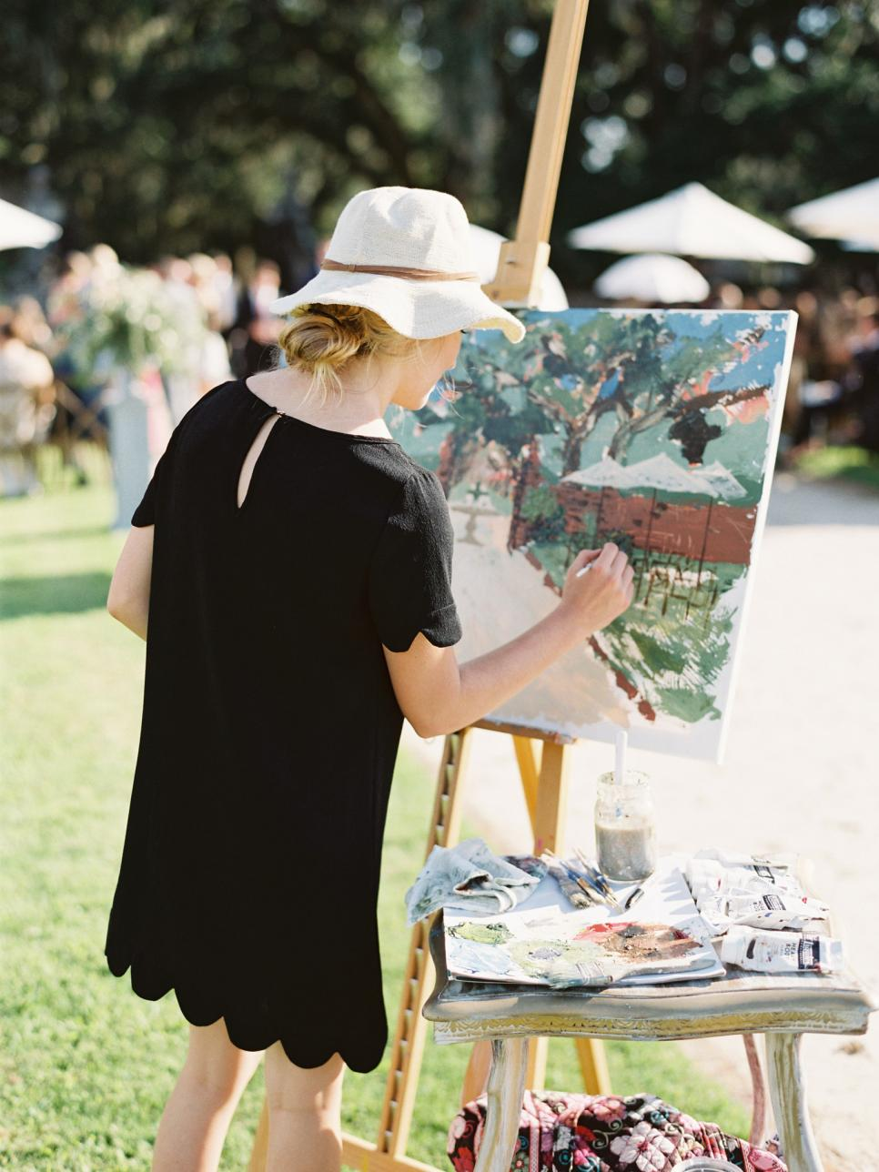 Artist Creates a Live Painting of a Sunny Wedding Reception