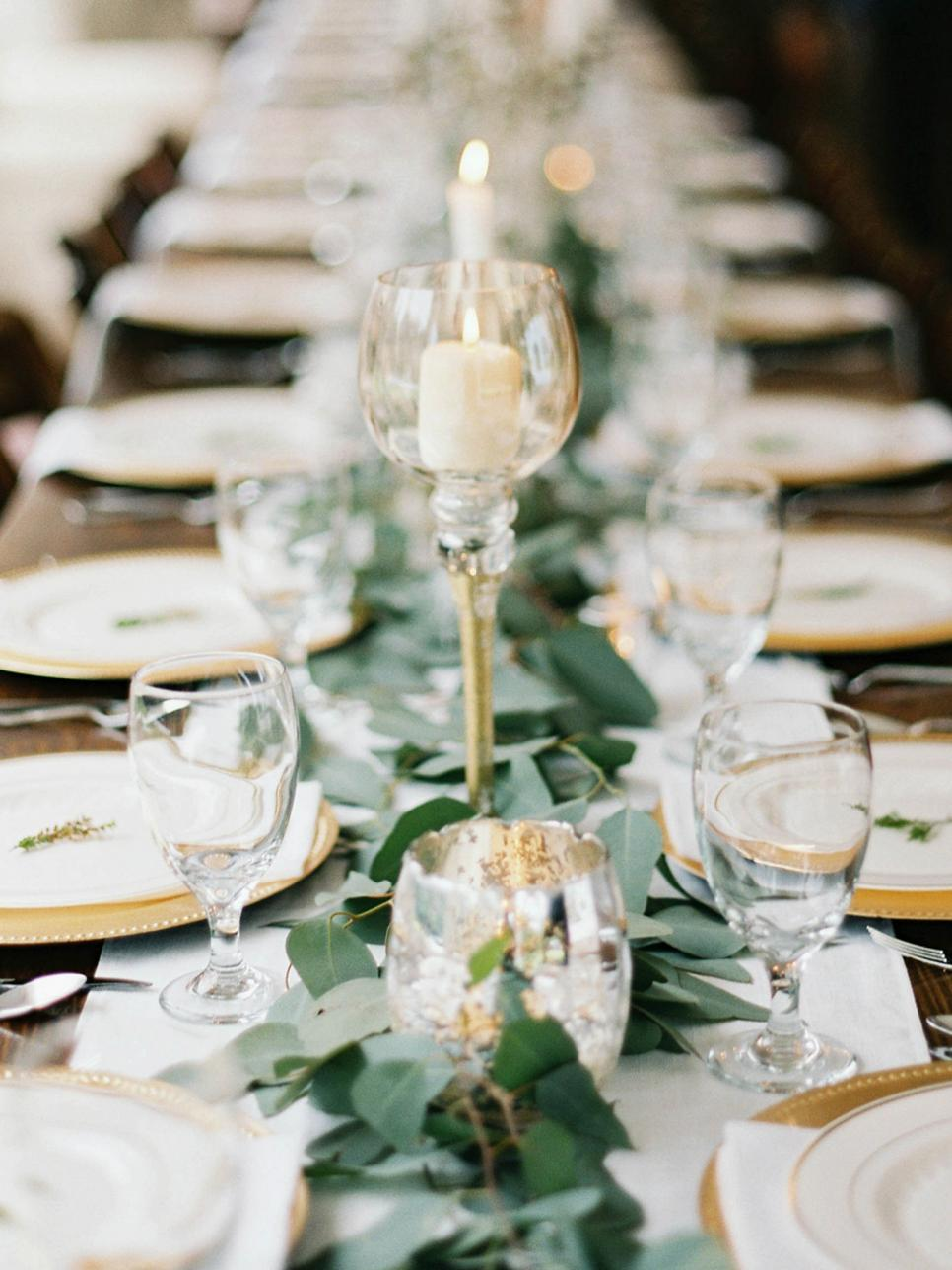 Long Set Table With Greenery Centerpiece and Candles