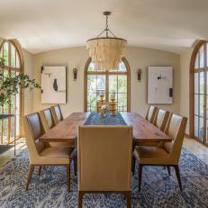 Spanish Mediterranean Dining Room With Ikat Rug