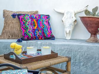 Faux Cattle Head and Colorful Pillows Decorate Concrete Patio