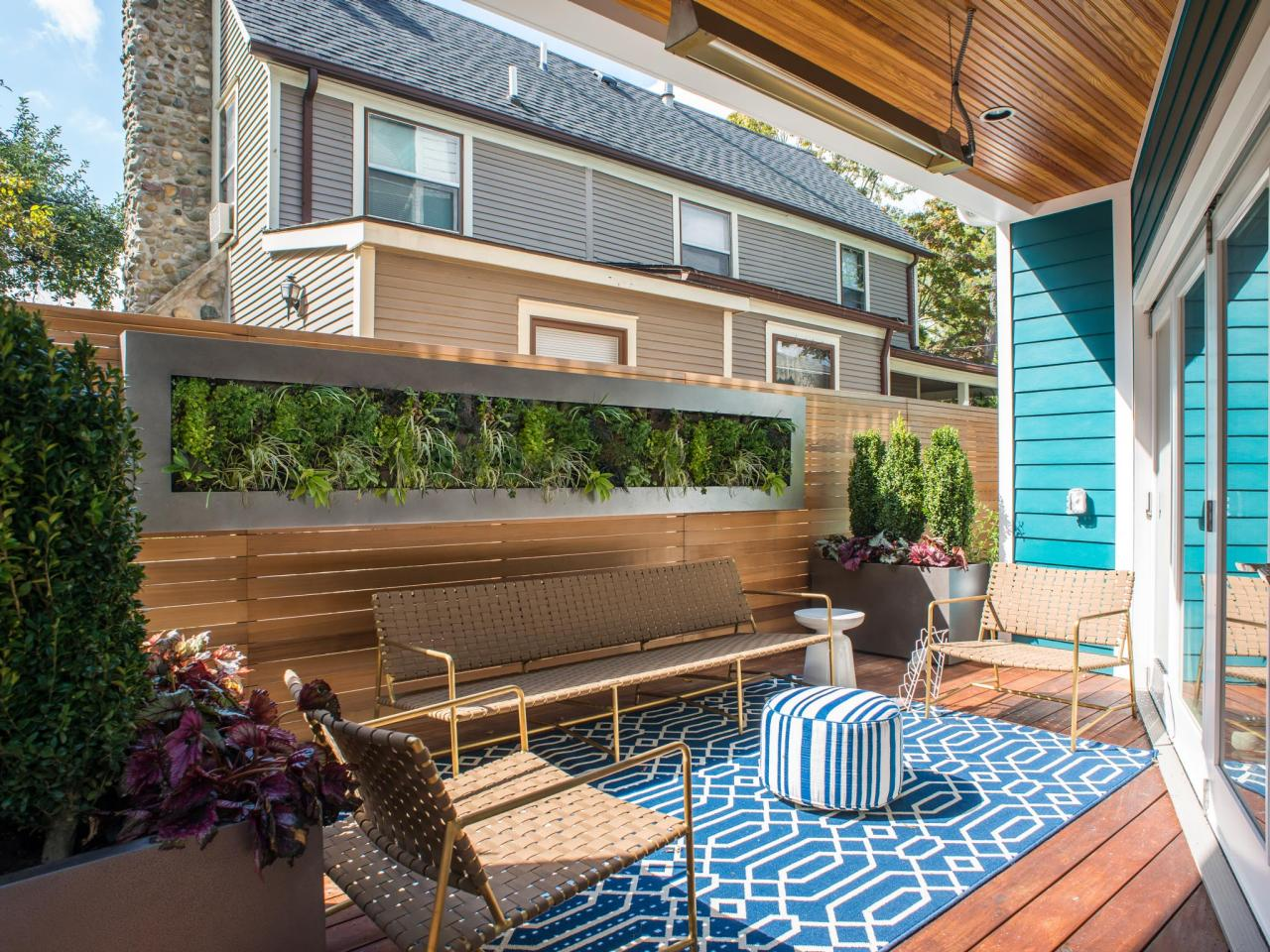 Small Deck With Custom Vertical Garden Wood Privacy Wall And Bright Blue Accents