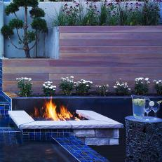 Modern Stone Fire Pit and Tiered Wooden Planters
