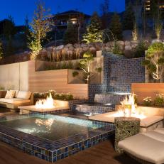Modern Outdoor Lounge Area With Water Feature and Fire Pits