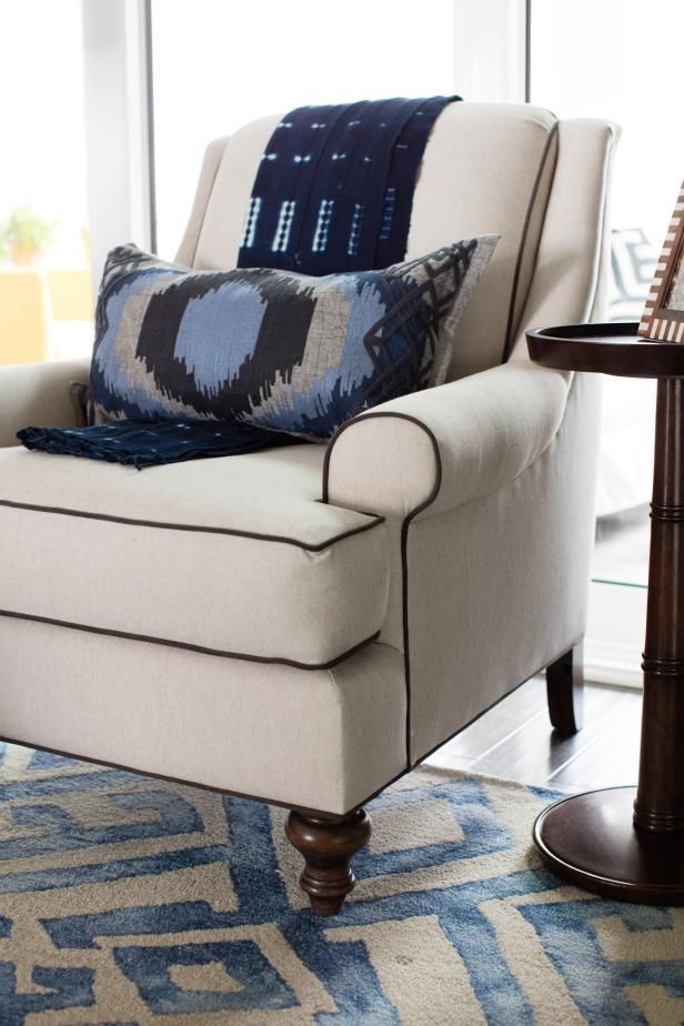 HGTV Smart Home 2016 Neutral Armchair With Blue Patterned Pillow