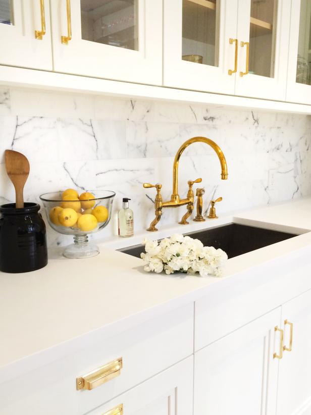 Kitchen Sink With Gold Faucet and White Counters