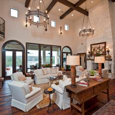 Spanish Living Room with Beamed Ceiling, Stone Fireplace