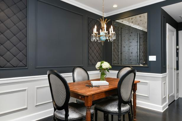 Black and White Dining Area with Mirror and Chandelier