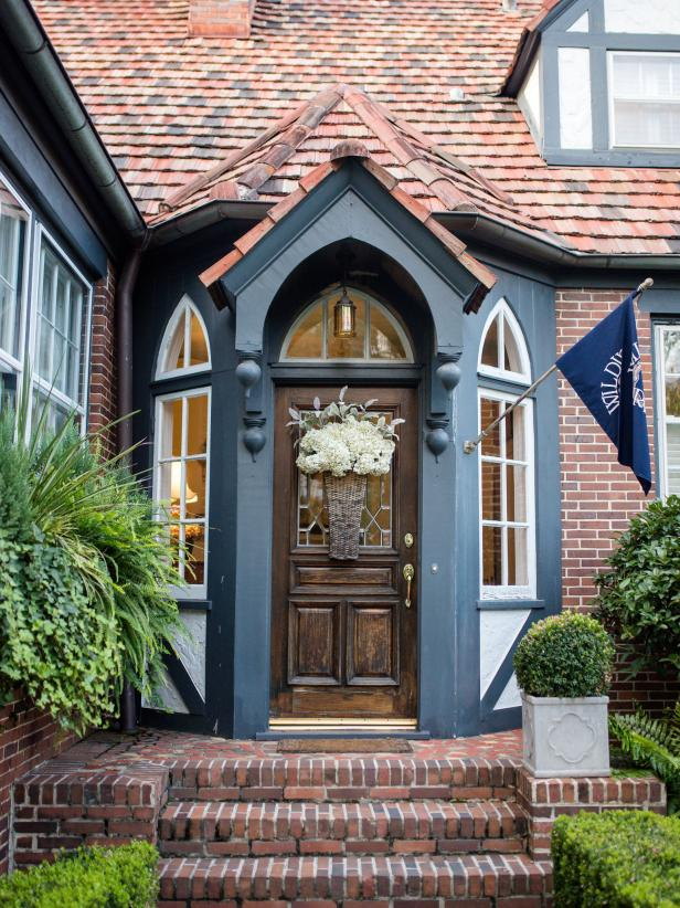 Tudor-style Front Entryway with Brick Steps