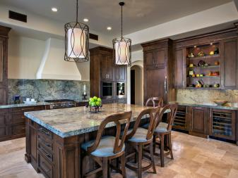 Spacious Mediterranean Eat-In Kitchen With Gray Marble Countertops