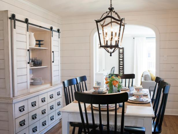 White Dining Room With Shiplap Walls, Large Buffet and Hutch and Country Lantern Chandelier