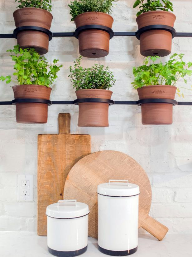 Black Metal Mounts and Ceramic Pots for Indoor Herb Garden in Bright, White Kitchen