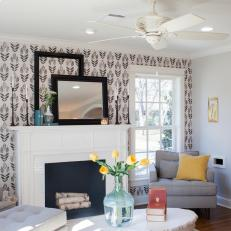 Sunny, Contemporary Living Room With Black and White Patterned Accent Wall and Tufted Furniture