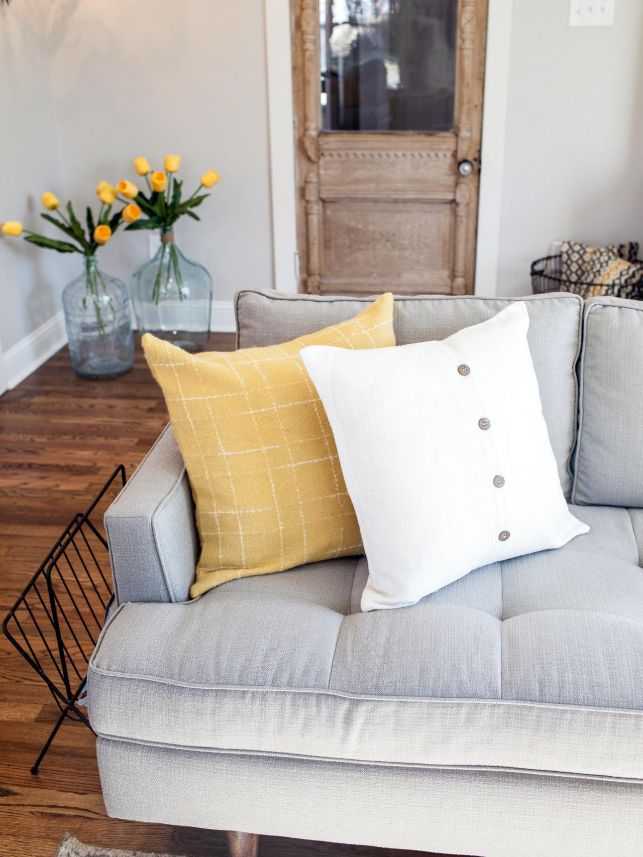Mid-Century Modern Sofa With Yellow and White Throw Pillows in ...