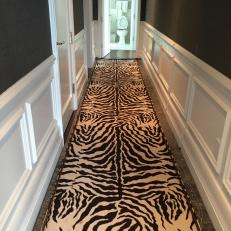 White Wainscoting, Charcoal Gray Walls and Zebra Runner in Transitional Hallway