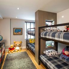 Children's Bedroom With Double Dunk Beds, Plaid Bed Linens, and Stuffed Animal Collection