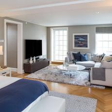 Gorgeous Contemporary Connected Bedroom and Living Room With Soft Gray Tones, Blue Accents and Soft Texture