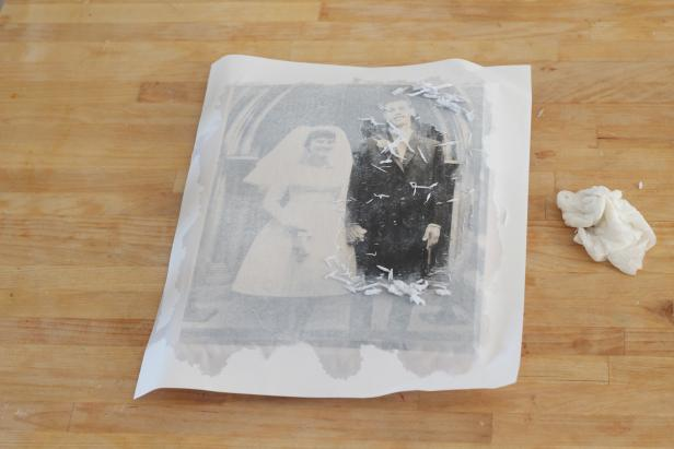 Step 4: Use the cloth to lightly scrub the paper away revealing the image underneath. Continue to add water and lightly scrub until all of the paper is gone.