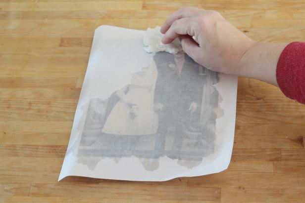 Step 4: Wet the paper with a damp cloth.