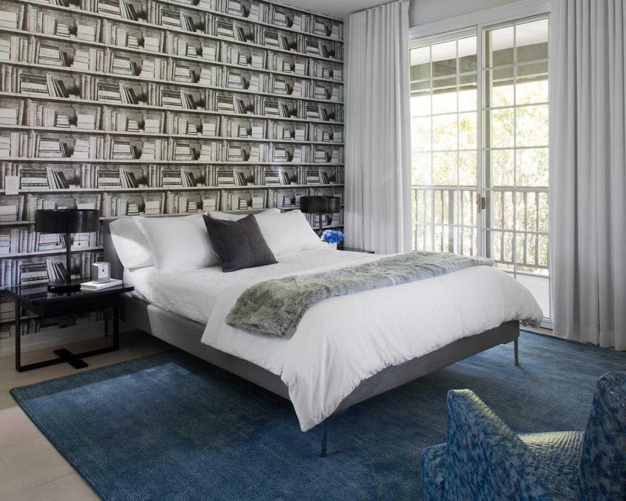 black white and blue bedroom modern bedroom with black and white bookshelf wallpaper blue area rug and white bed linens hgtv 9723