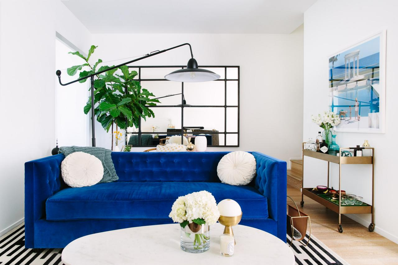 Eclectic living room with blue sofa