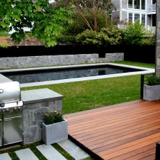 Contemporary Backyard With Grill Station And Swimming Pool