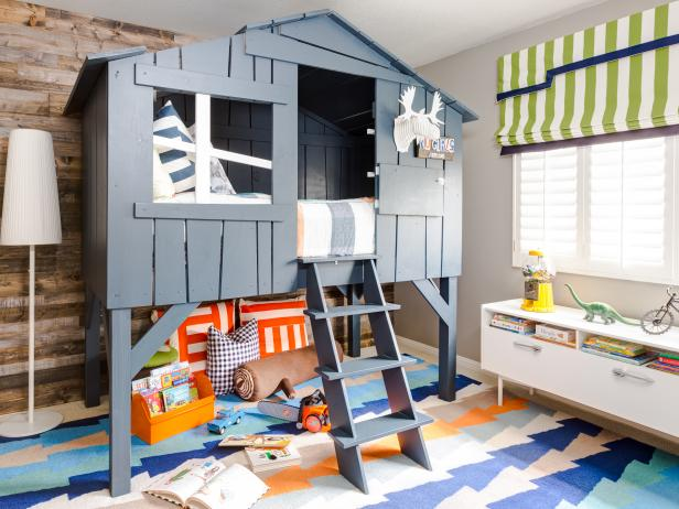 A Treehouse-Style Loft Bed and Reclaimed Wood Wall Draw the Eye In To This Big Boy Bedroom