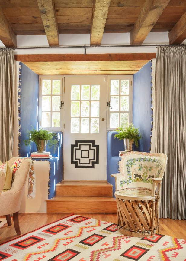 Blue Foyer With a Southwestern Rug and Exposed Beam Ceiling