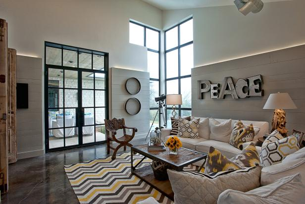 Eclectic Gray And Yellow Sitting Room With Gray Shiplap Walls