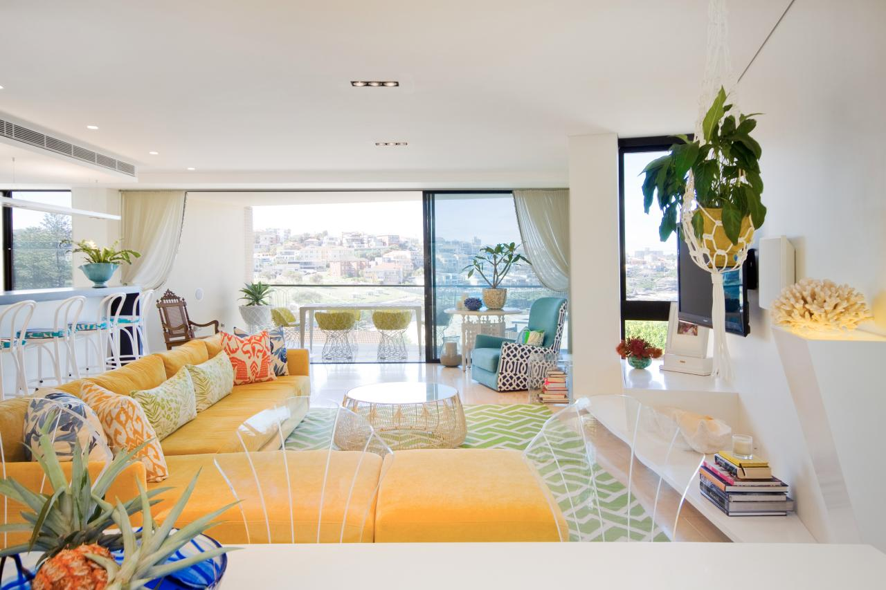 Open Plan Tropical Living Space With Yellow Sofa | HGTV