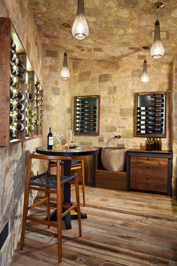 Spacious Wine Cellar With Rustic Stone Ceiling and Walls