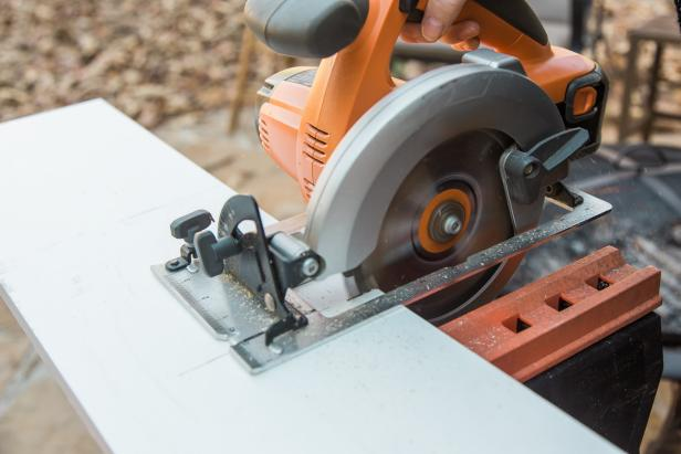 "Have the three pieces of wood cut for you at a home improvement center or measure and mark 3 pieces of the 1""x 8"" pine at 18 inches long, then cut them using a circular saw at home. Sand off any rough edges, as needed."