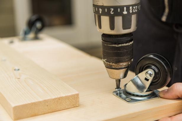 "While the base is still flipped upside down, install the casters on each corner. First, measure and mark for placement- 1 inch from each edge. Next, fasten using #10 1"" wood screws."