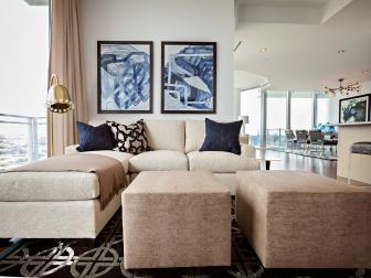 Neutral and Blue Sitting Room With Ottomans