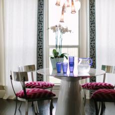 Art Deco Dining Room With Pink Pillows