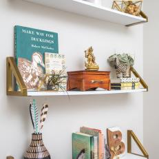 Eclectic Mix of Accessories on Floating Shelves