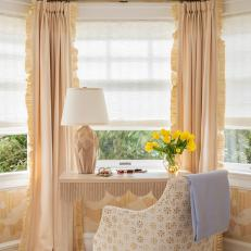 Elegant Window Desk Set Up With Ruffle Trimmed Curtains Gold Patterned Armchair And Yellow Tulips