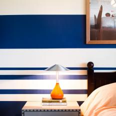 Detail of Nightstand and Blue & White Striped Wall