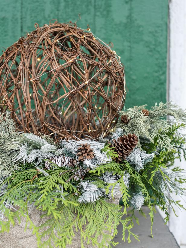 For simple, but high impact arrangement for a porch or entryway, try these lighted grapevine spheres.  They are a great way to fill urns that have been left empty once the summer and fall flowers fade.