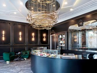 Art Decor Macaron Bakery With Brass Chandelier, Crescent Bar and Jade Velvet Chairs