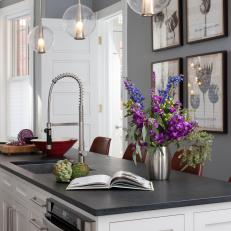 Transitional Eat In Kitchen With Black Island Countertop