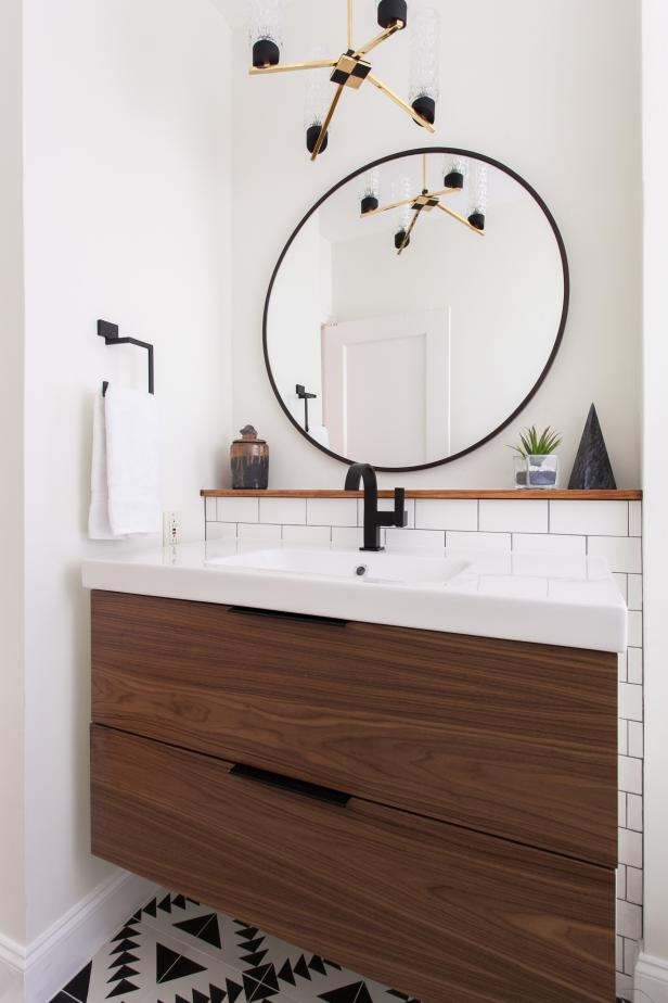 Black And White Single Vanity Bathroom With Round Mirror