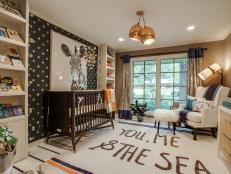 A neutral color palette mixes with graphic prints, luxurious textures and metallic accessories for a unique gender-neutral nursery. Turnstyle Interior Design included built-in bookcases and lots of floor space for a room that will grow with the child.