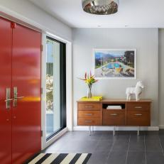Midcentury Entry With Striped Rug and Console Table