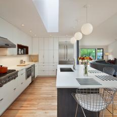 Stylish, Midcentury Modern Kitchen With Bertoia Barstools