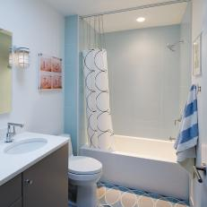 Serene Bathroom With Circular Pattern Tile Floor