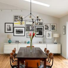 Chic, Midcentury Dining Room With Gallery Wall