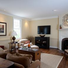 Traditional Living Room With White Fireplace And Flat Screen Tv