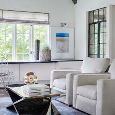 Bright Sunroom With Reflective Coffee Table